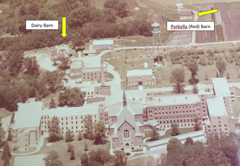 Historic aerial view of Our Lady of Good Counsel in Mankato, Minnesota showing dairy barn and Pyrbylla (red) barn locations.