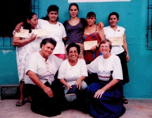 Sister Leetta Hammack worked with inmates in Paraguay. She is pictured with some of the prisoners and volunteers.