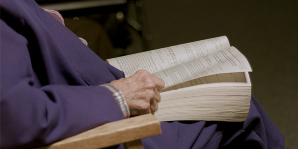Sister praying with a bible for peace at Notre Dame of Elm Grove in Elm Grove, Wisconsin.