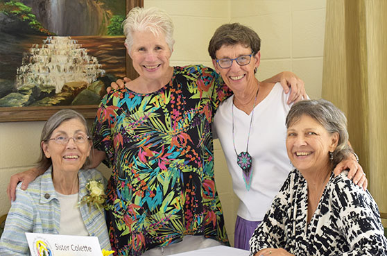 Sisters Collette Kraus and Judy Bourg along with Helen Addision and Sister Collette's sister pose for a photo at St. Mary of the Pines in Chatawa, Mississippi.