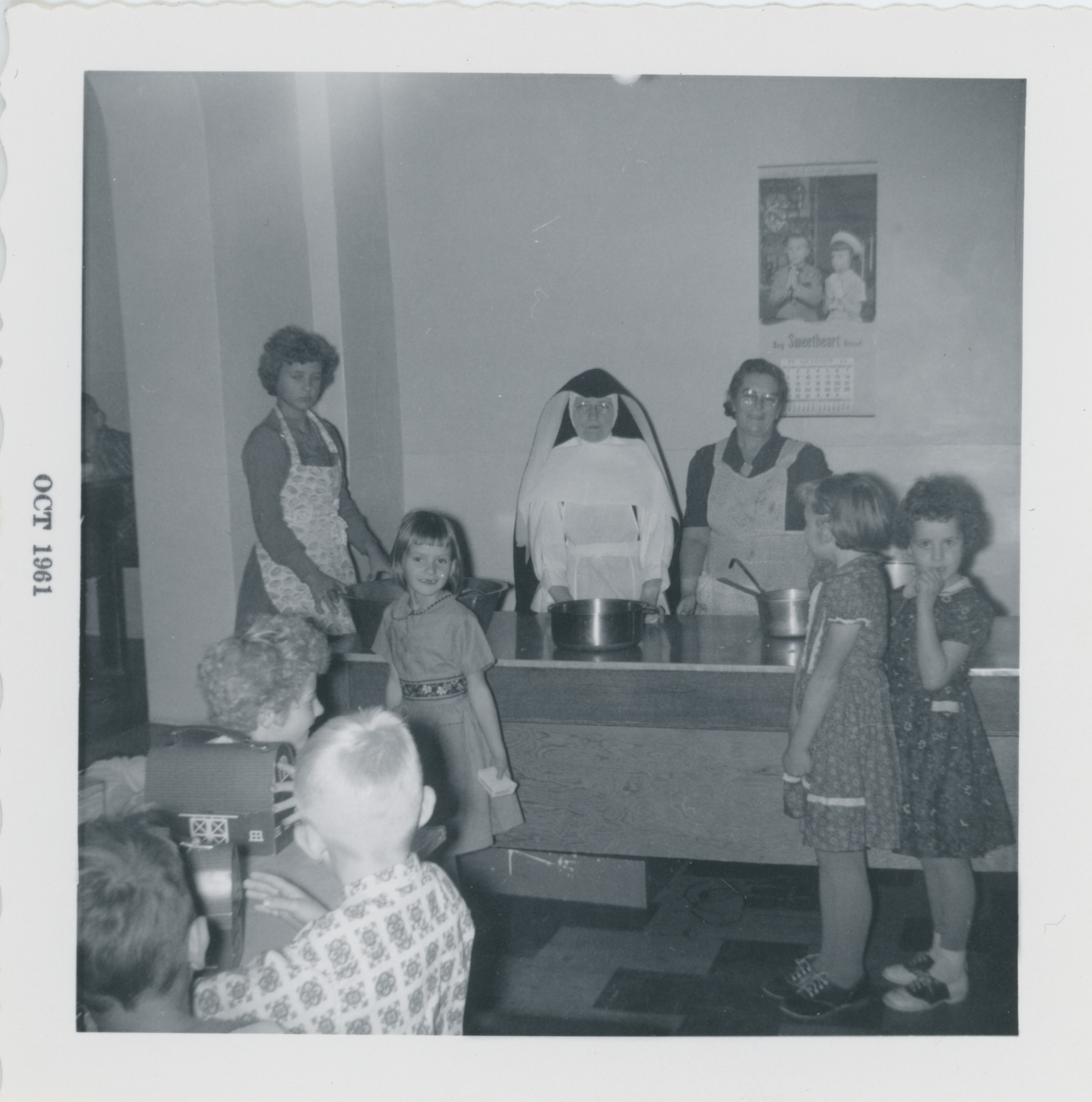 Boarders with cooks at St. Pius, Scheffield (Courtesy of SSND North American Archives)